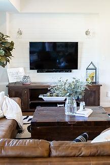 Lisa Clark Design Winnipeg Manitoba Steinbach Interior Design farmhouse living room media wall shiplap leather sofa