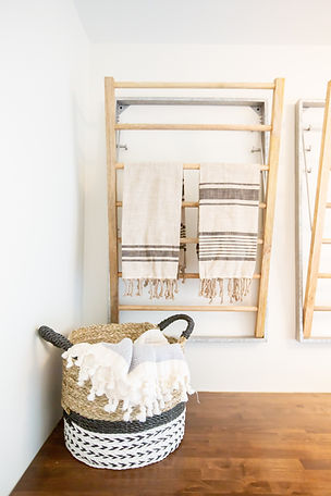 Lisa Clark Design Winnipeg Manitoba Steinbach Interior Design farmhouse laundry wood countertops barn doors white cabinets drying rack
