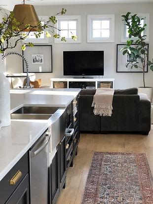 Lisa Clark Design Interior Design Steinbach Winnipeg Manitoba White kitchen black island brass hardware classic marble oriental runner