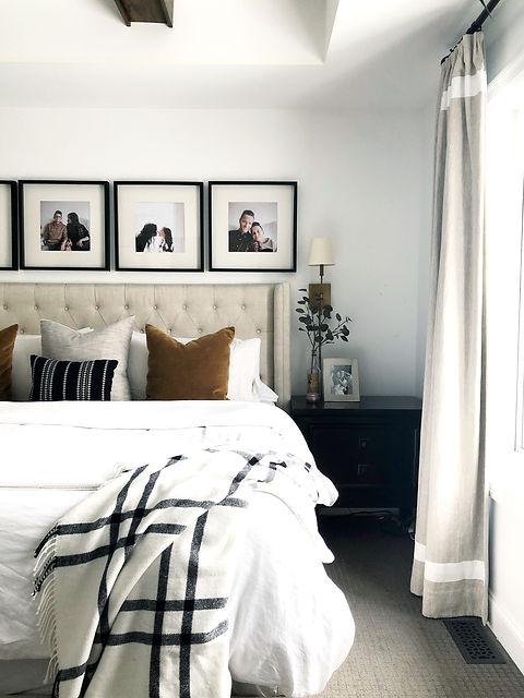 Lisa Clark Design Interior Design Steinbach Winnipeg Manitoba master bedroom king bed white linen brass sconces beams