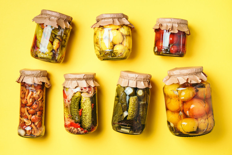 canned-and-preserved-vegetables-in-glass-jars-over-KATXBQT.jpg