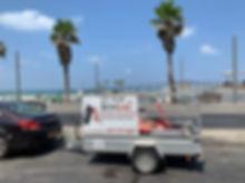 ניידת שירות ל BenGal חונה בתל אביב על מנת לחלץ רכב