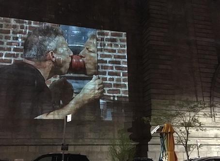 Performance projection on Manhattan Bridge in Dumbo, Brooklyn