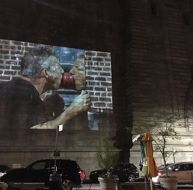Performance projection on Manhattan Bridge in Dumbo, Brooklyn