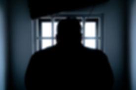 silhouette-of-a-man-in-window-143580 (1)