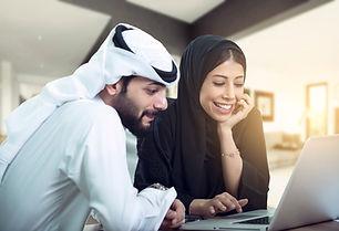 lovely Arabic Couple sitting using lapto