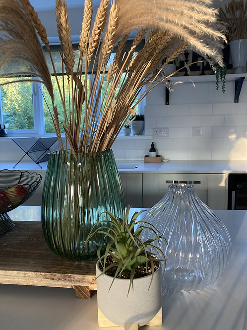 Fluted green glass vase