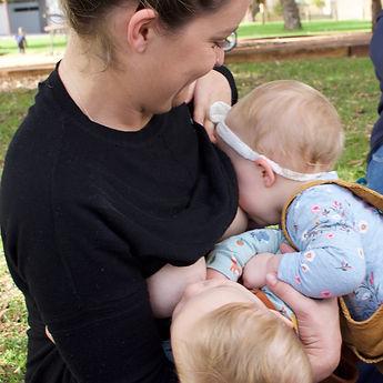 mom breastfeeding twins