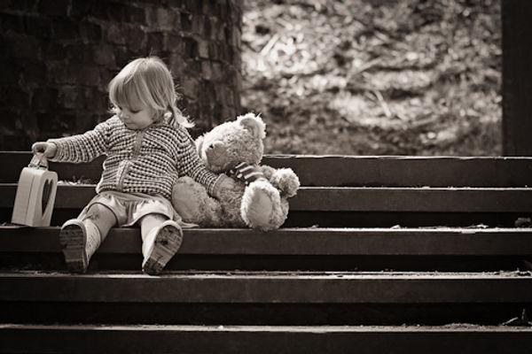 A little girl and her teddy bear