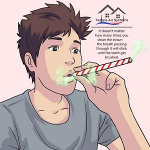 Male blowing air through a straw.