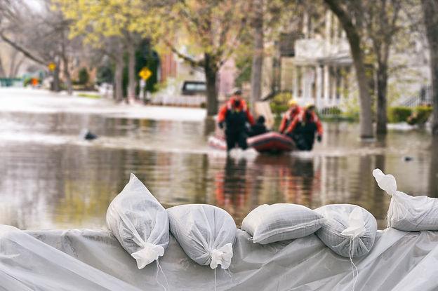 Flooded road with sandbags AdobeStock_169465415