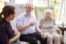 Woman sitting with older couple (Adobe stock image)