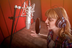 female-with-microphone-recording-a-voice