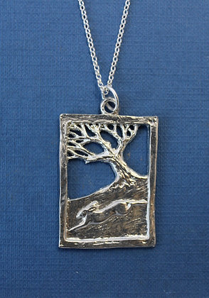 Hare running past tree pendant.