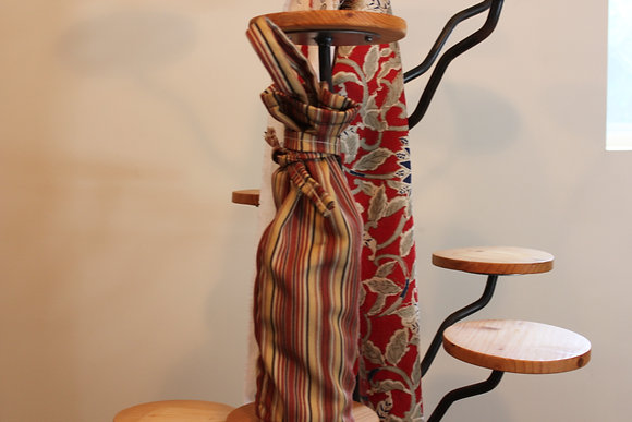 A colorful pinstriped Wine bag