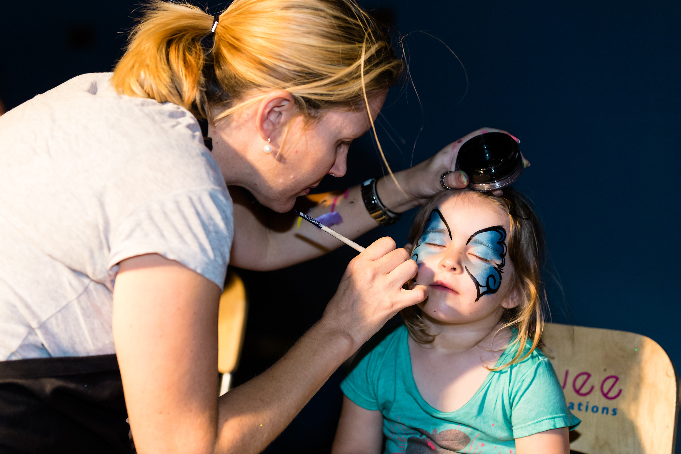 young girl getting face painted