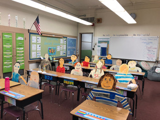 Students in Ms. Cyr's class created self portraits for open house this week!