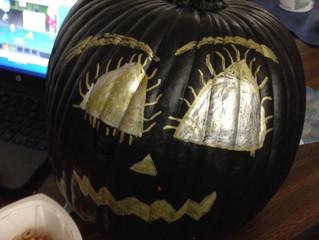 6th graders decorating pumpkins