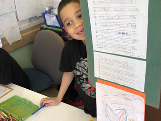 2nd grade reading group create their own stories with illustrations.