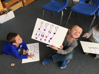 1st graders composing 4-beat rhythms in music class