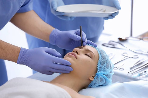bigstock-Plastic-surgeon-drawing-marks-1
