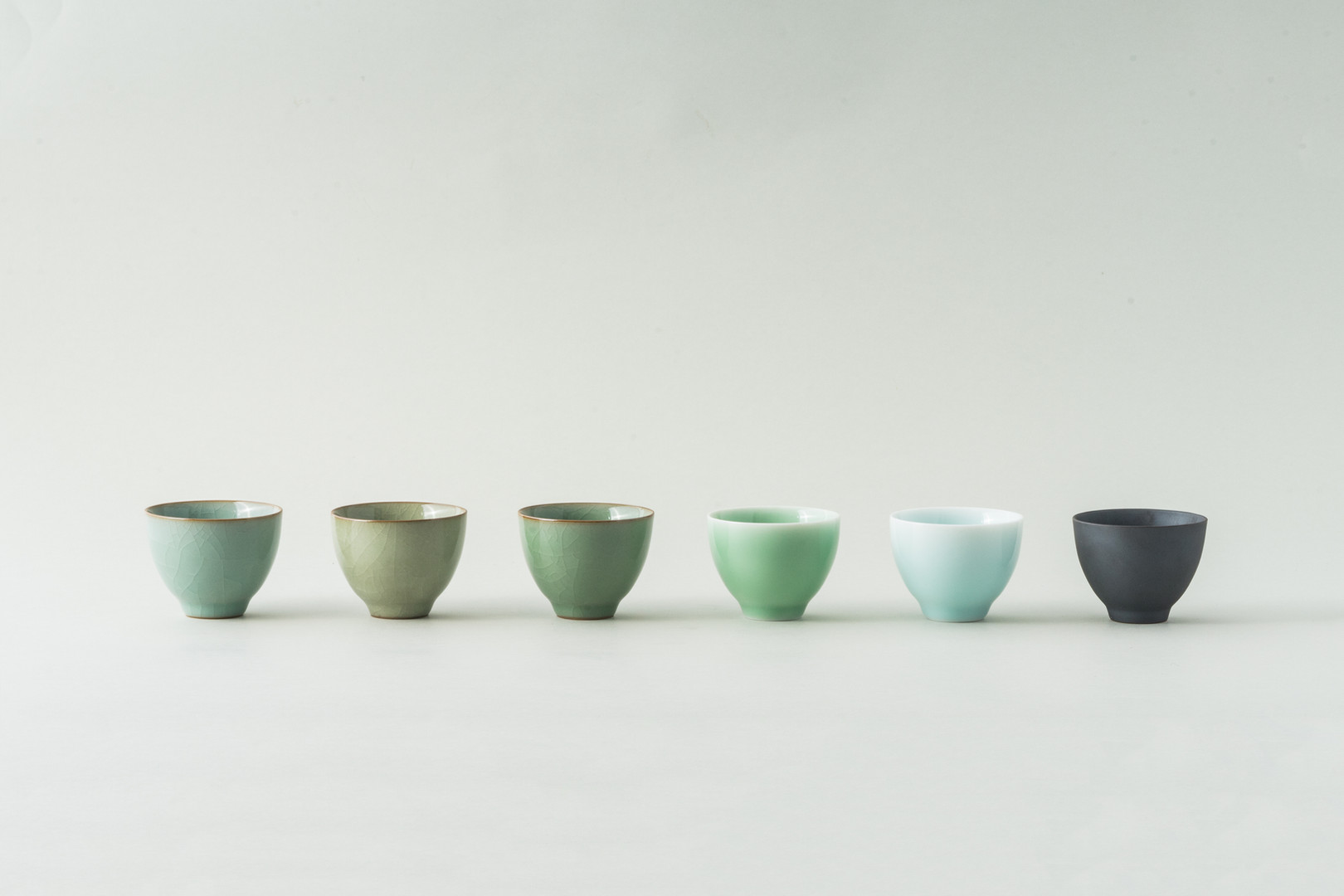 Tiny off the hump pottery cups