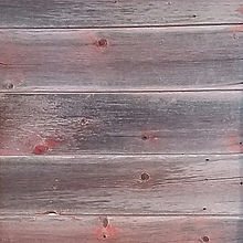 Rustic antique weathered reclaimed faded red to gray barn wood sidng