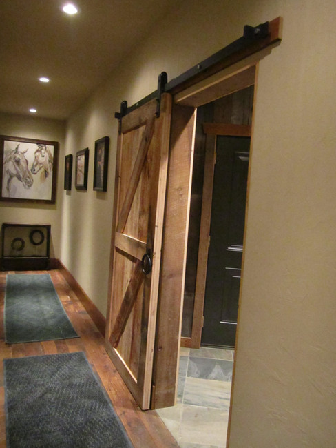 Rustic reclaimed barn wood door and hardware