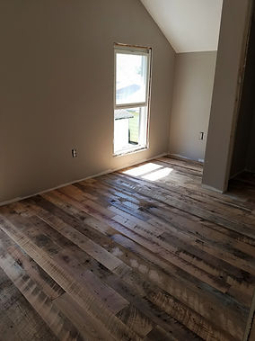 Reclaimed barn wood flooring unfinished.