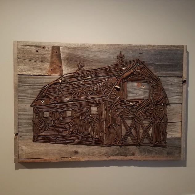 Reclaimed barn wood and nail barn art