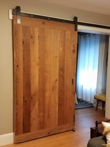 Solid barn door with strap barn door har