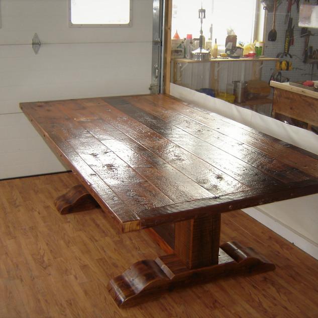 Reclaimed tressle base barn wood table