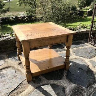Small oak coffee table with boarded top and bread board end.jpg