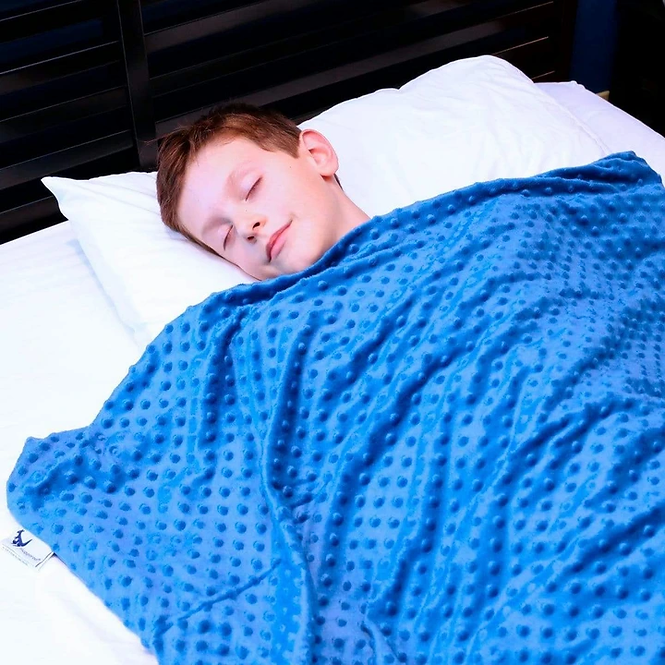 boy with a blue blanket