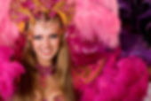 Portrait of young woman in pink carnival