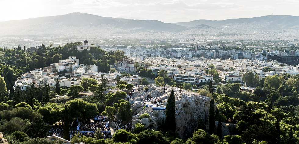 A panorama of Athens Greece viewed from the acropolis at sunset.