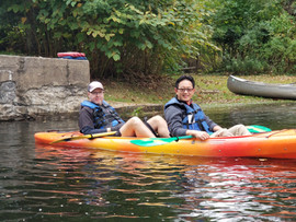 Dr. Joe in a canoe with Henry