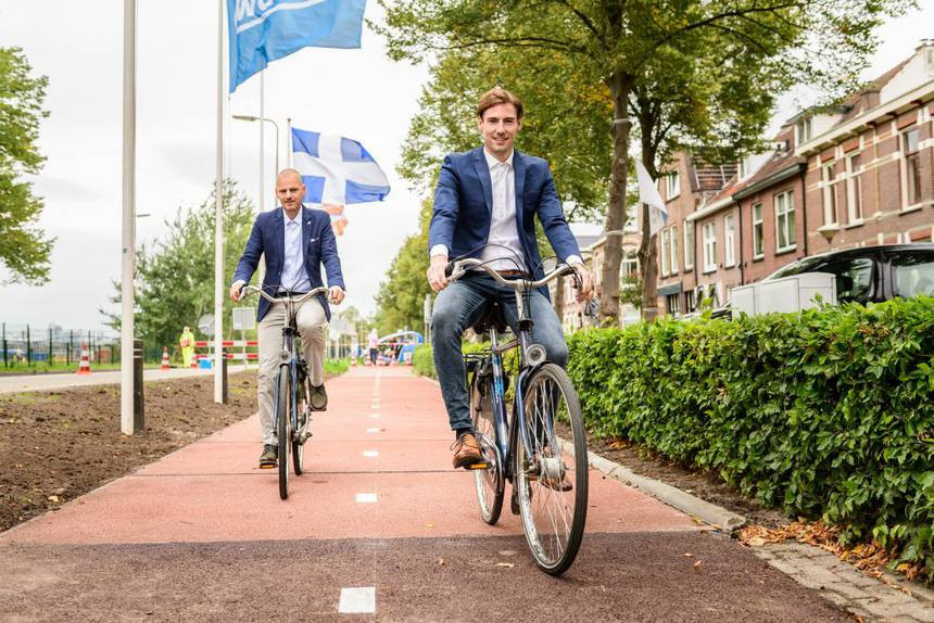 PlasticRoad inventors Simon Jorritsma and Anne Koudstaal riding on PlasticRoad. World's first bike path made from recycled plastic. Perfect for green, eco friendly commuters like Me-Mover owners.