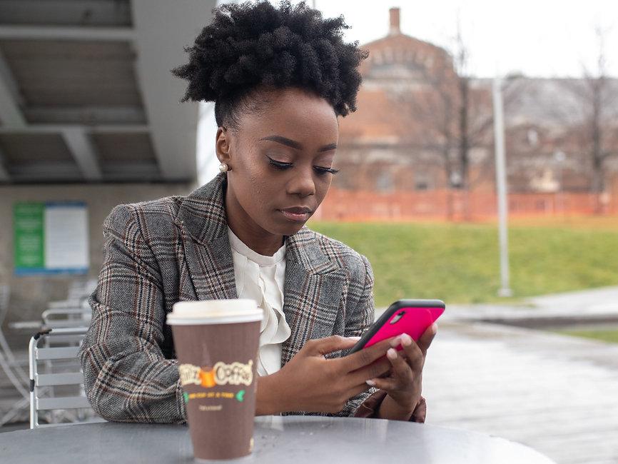 Girl texting on phone - 2560x1922.jpg