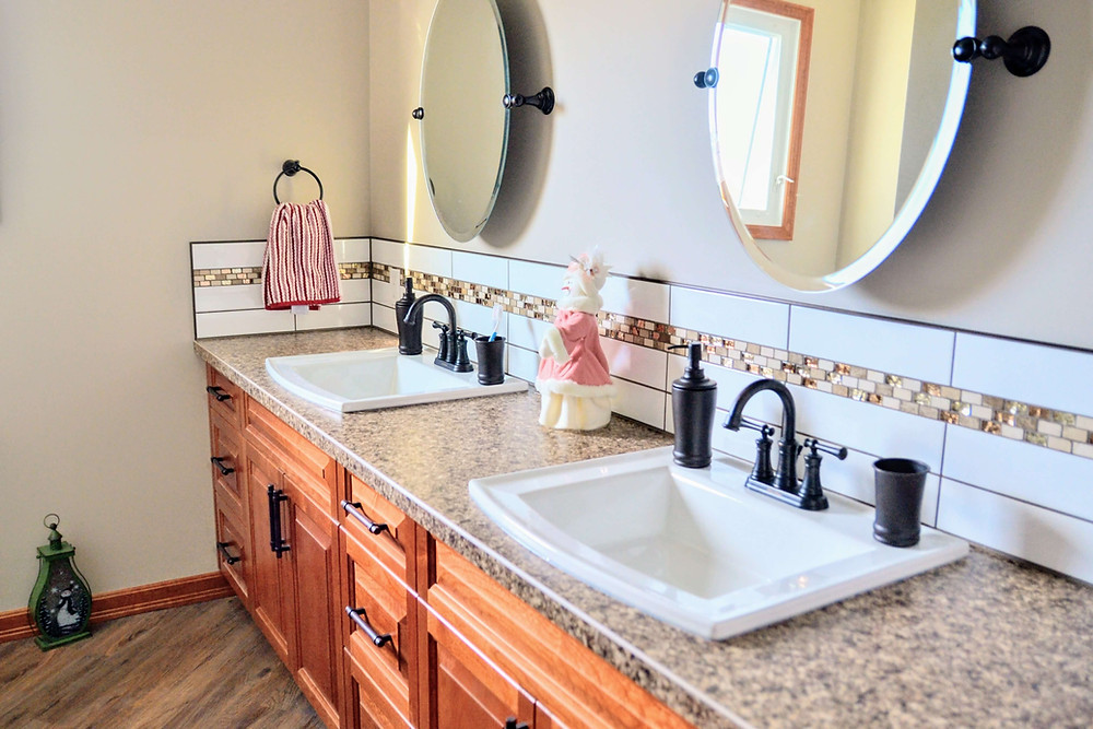 His and Her sinks set in a custom cherry wood vanity.