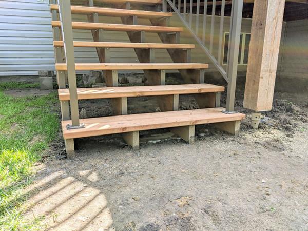 Deck stairs landing on aluminum beam.jpg