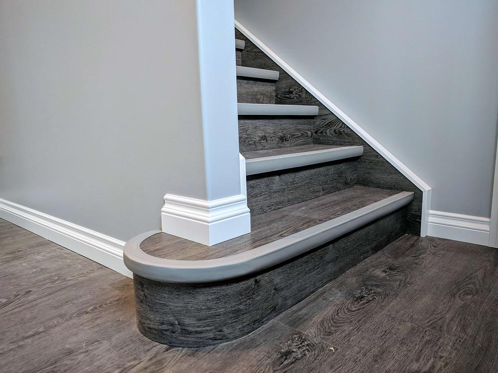 Vinyl plank flooring with trim painted in situ.