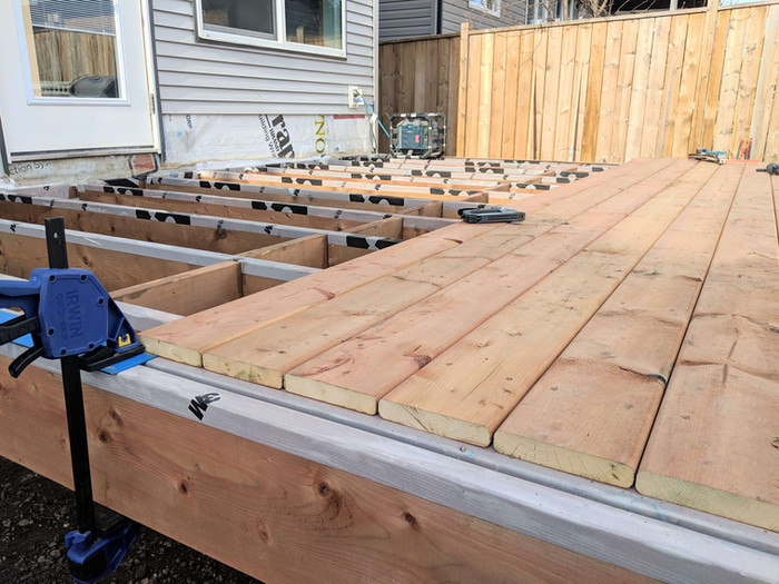 Partially finished pressure treated deck.