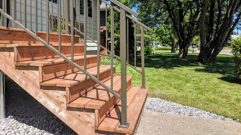 These wide front entry stairs portrayan invitation. Building oversizedsteps also leave room for seasonal decorations and flower planters.