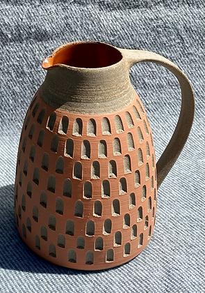Stoneware jug with orange checkerboard