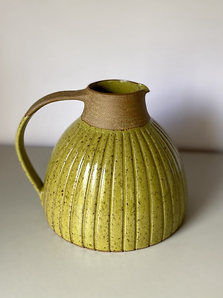 Stoneware jug with incised lines and yellow glaze