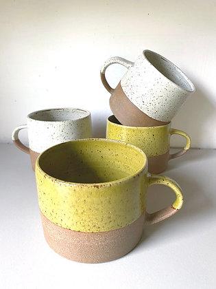 Stoneware mugs with yellow glaze