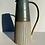 Thumbnail: Stoneware jug with deep sea blue glaze and inlaid slip lines