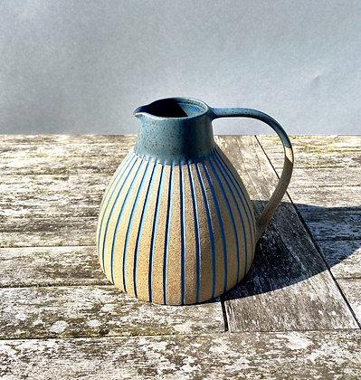 Stoneware jug with slip inlaid lines and sea blue glaze