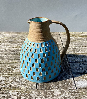 Stoneware jug with blue checkerboard slip decoration and duck egg blue glaze